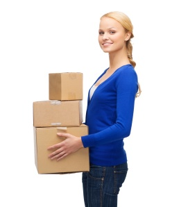 smiling woman in casual clothes with parcel boxes