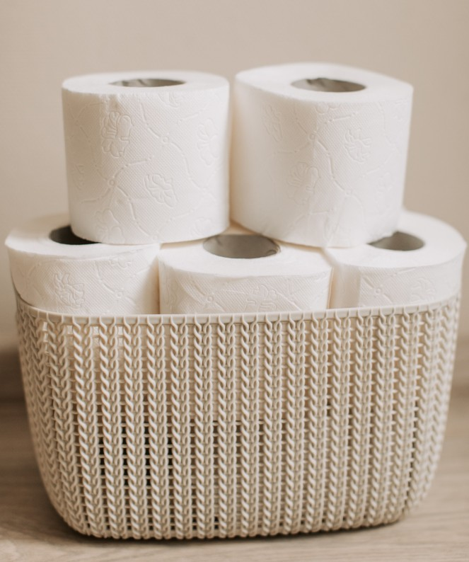 cropped stack-of-toilet-paper-rolls-in-a-basket-3958185